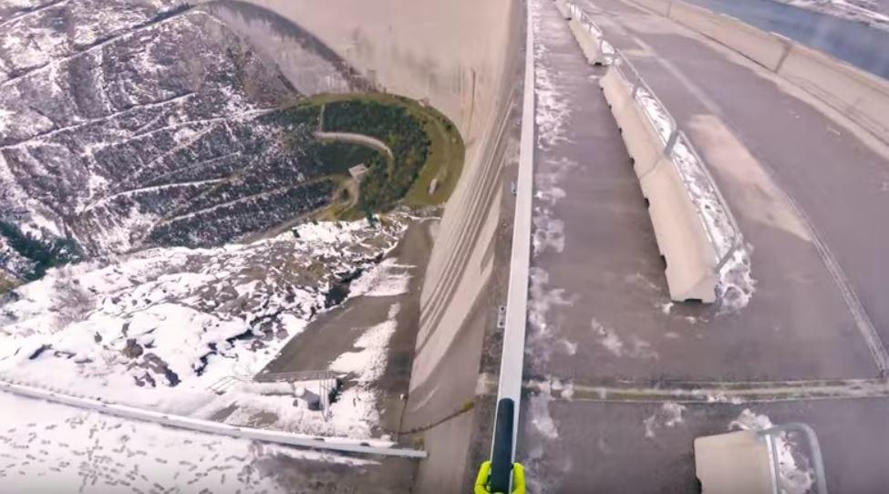 Mountain biker riding on a ledge