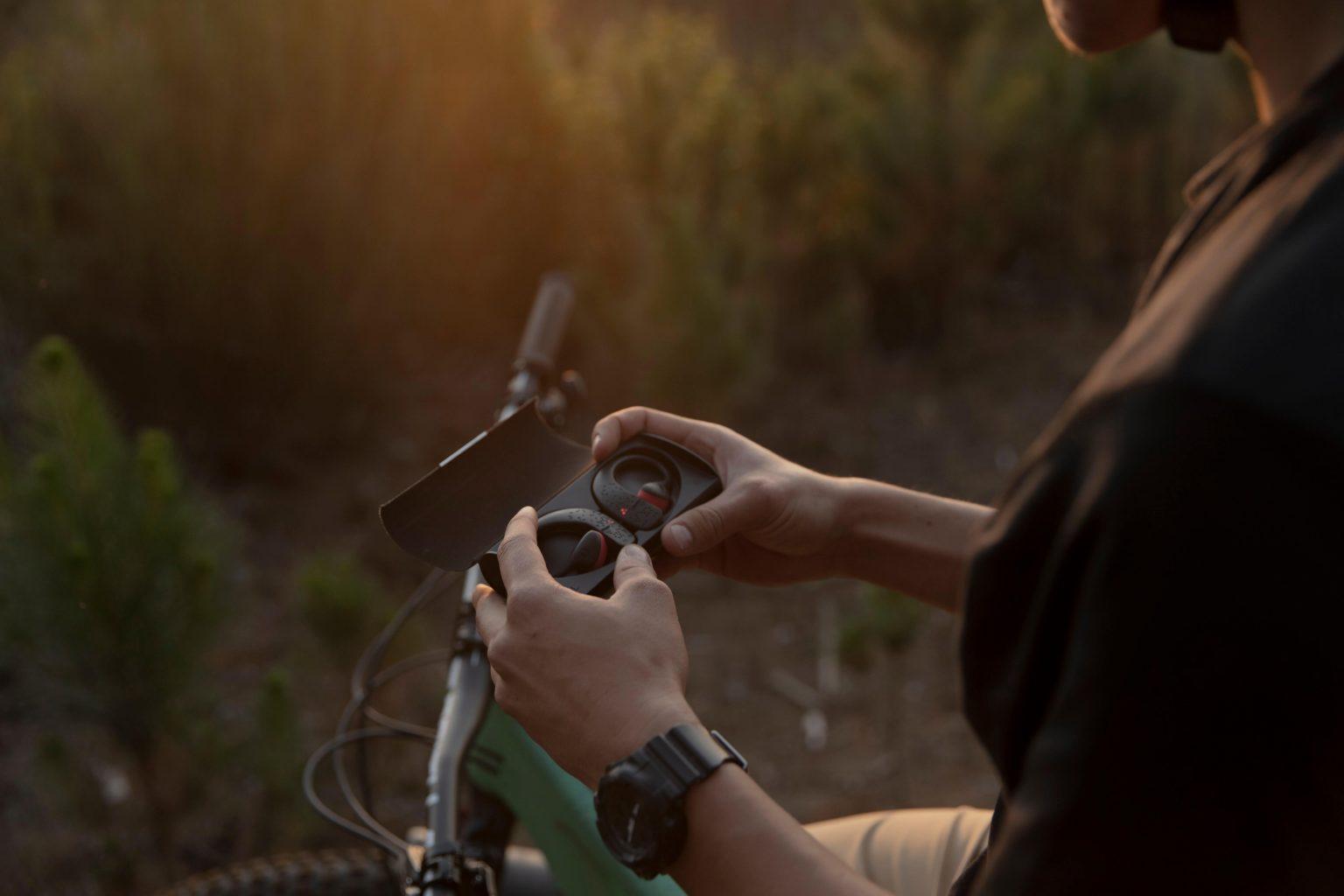 earSHOTS Bluetooth Headphones inside case with Mountain Bike