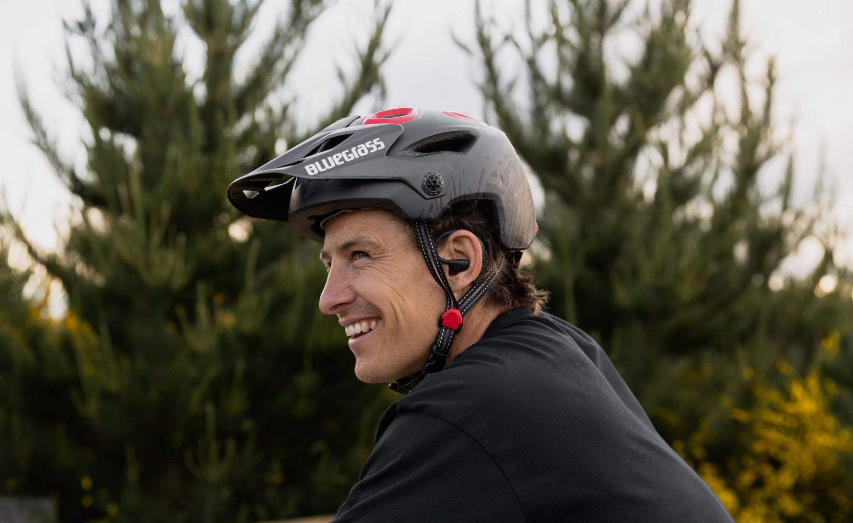 earSHOTS Bluetooth headphones sideview with Helmet and Mountain Biker